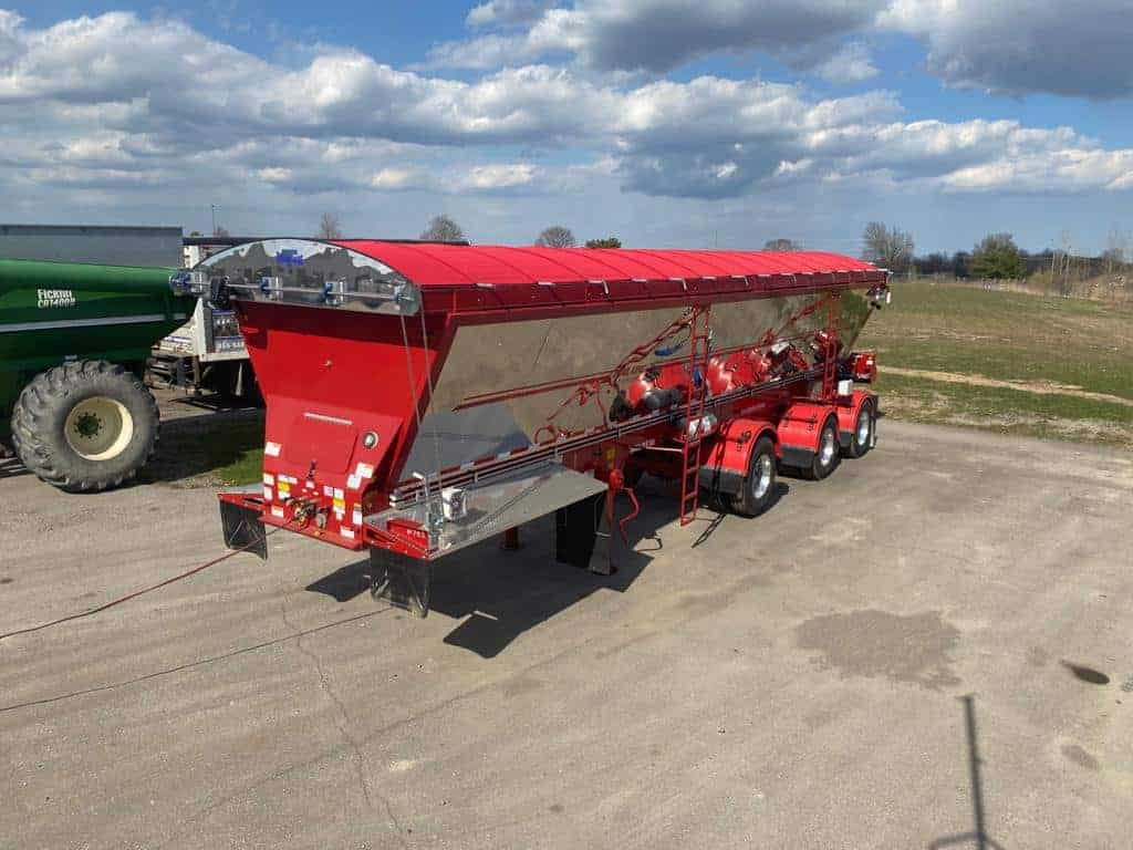 Red River Trailer with Red Mesh Cable Tarp System cloud background